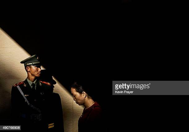 A Chinese paramilitary police officer guards in an underground tunnel after securing the official flag raising ceremony at Tiananmen Square to mark...