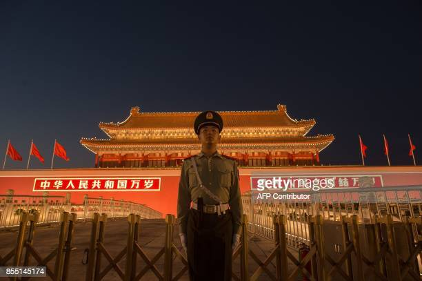 A Chinese paramilitary police officer secures the front gate of the Forbidden City in Beijing on September 28 2017 China will convene its 19th Party...