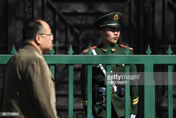 A Chinese paramilitary police officer stands guard outside the North Korean embassy in Beijing on March 31 2017 A flight from Malaysia believed to be...