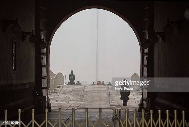 Chinese Paramilitary police officer yawns as he stands guard at Tiananmen Gate during a day of high pollution in Tiananmen Square on December 1 2015...