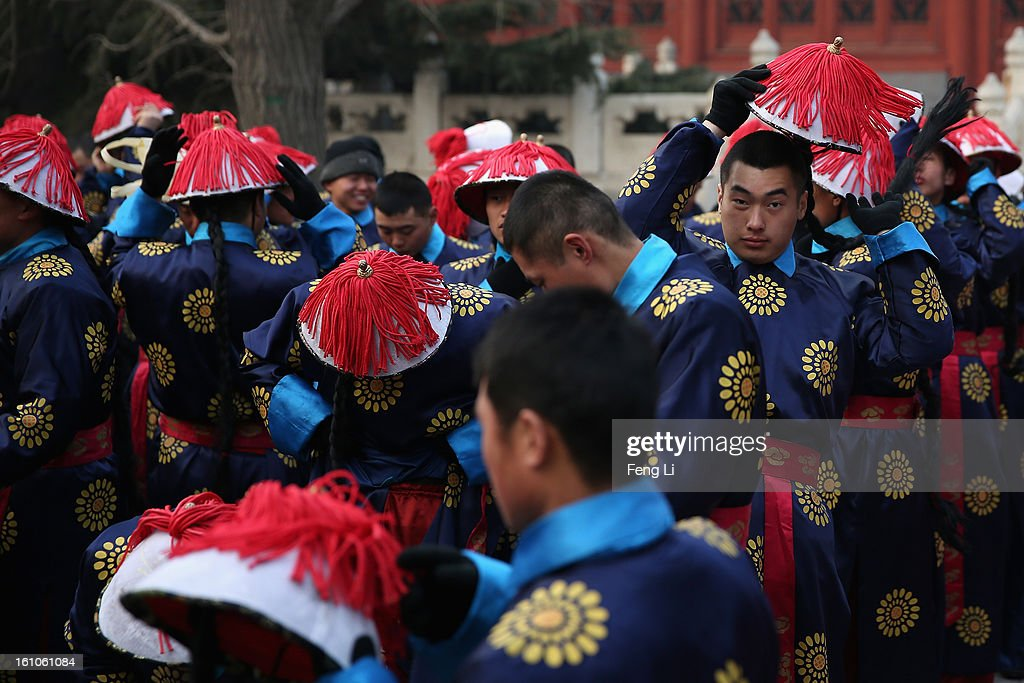 Chinese paramilitary police officers dressed as Qing Dynasty servants before a re-enactment of an ancient ceremony of Qing Dynasty emperors praying for good harvest and fortune during the opening ceremony of the Spring Festival Temple Fair at the Temple of Earth park on February 9, 2013 in Beijing, China. The Chinese Lunar New Year of Snake also known as the Spring Festival, which is based on the Lunisolar Chinese calendar, is celebrated from the first day of the first month of the lunar year and ends with Lantern Festival on the Fifteenth day.