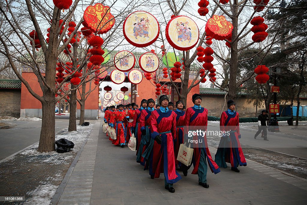 Chinese paramilitary police officers dressed as Qing Dynasty servants march before a re-enactment of an ancient ceremony of Qing Dynasty emperors praying for good harvest and fortune during the opening ceremony of the Spring Festival Temple Fair at the Temple of Earth park on February 9, 2013 in Beijing, China. The Chinese Lunar New Year of Snake also known as the Spring Festival, which is based on the Lunisolar Chinese calendar, is celebrated from the first day of the first month of the lunar year and ends with Lantern Festival on the Fifteenth day.