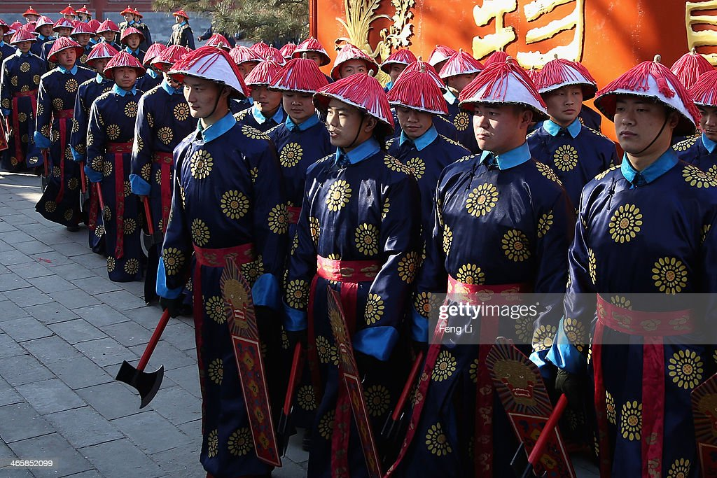 Chinese paramilitary police officers dressed as Qing Dynasty servants before a re-enactment of an ancient ceremony of Qing Dynasty emperors praying for good harvest and fortune during the opening ceremony of the Spring Festival Temple Fair at the Temple of Earth park on January 30, 2014 in Beijing, China. The Chinese Lunar New Year of Horse also known as the Spring Festival, which is based on the Lunisolar Chinese calendar, is celebrated from the first day of the first month of the lunar year and ends with Lantern Festival on the Fifteenth day.