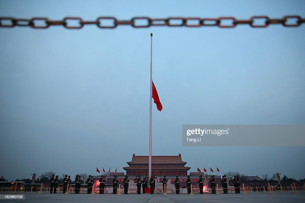 Chinese paramilitary police officers guard during the flag-lowering ceremony in front of the Tiananmen Gate on March 2, 2013 in Beijing, China. The reshuffle will be completed at the first annual session of the 12th National People's Congress (NPC), which is scheduled to begin on March 5, and the first annual session of the 12th National Committee of the Chinese People's Political Consultative Conference (CPPCC), which will commence on March 3.