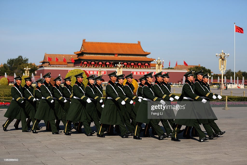 Chinese paramilitary police officers march after the closing session of the 18th National Congress of the Communist Party of China (CPC) at the Tiananmen Square on November 14, 2012 in Beijing, China. Members of the Standing Committee of the Political Bureau of the new CPC Central Committee will meet with journalists on November 15, 2012.