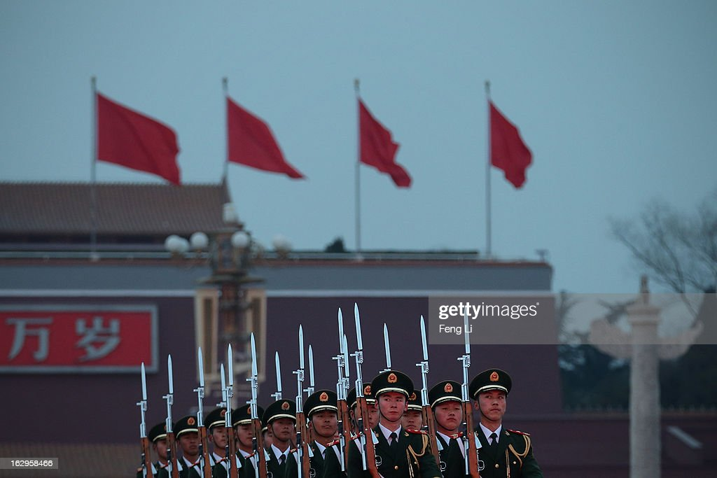 Chinese paramilitary police officers march during the flag-lowering ceremony in front of the Tiananmen Gate on March 2, 2013 in Beijing, China. The reshuffle will be completed at the first annual session of the 12th National People's Congress (NPC), which is scheduled to begin on March 5, and the first annual session of the 12th National Committee of the Chinese People's Political Consultative Conference (CPPCC), which will commence on March 3.
