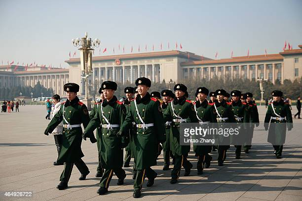 Chinese paramilitary police officers patrol Tiananmen Square on March 2 2015 in Beijing China The Third Session of the 12th National People's...