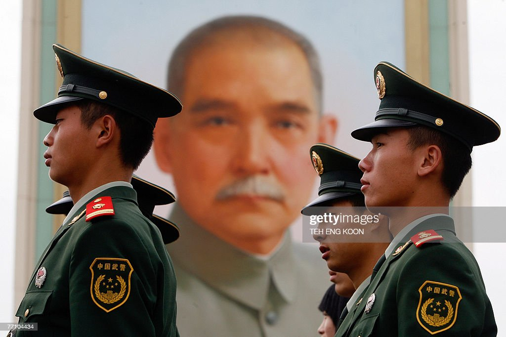 Chinese paramilitary police officers prepare to patrol in Beijing's Tiananmen Square, near a portrait of the founder of modern China Sun Yat-en, 29 September 2007. The Chinese capital is gearing up for its 58th National Day celebration 01 October and the 17th Communist Party Congress in mid-October, which could lead to personnel changes in the top echelons of power and will set China's political and economic course for the next five years. AFP PHOTO/TEH ENG KOON