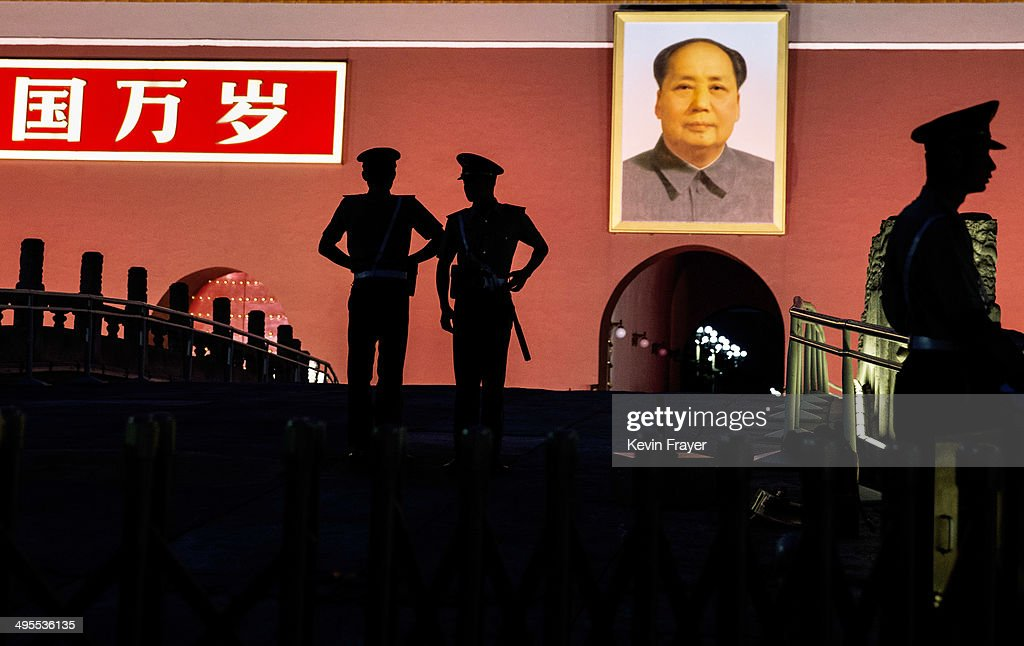Chinese Paramilitary police officers stand guard below a portrait of the late leader Mao Zedong in front of the Forbidden City at Tiananmen Square on June 4, 2014 in Beijing, China. Twenty-five years ago on June 4, 1989 Chinese troops cracked down on pro-democracy protesters and in the clashes that followed scores were killed and injured.