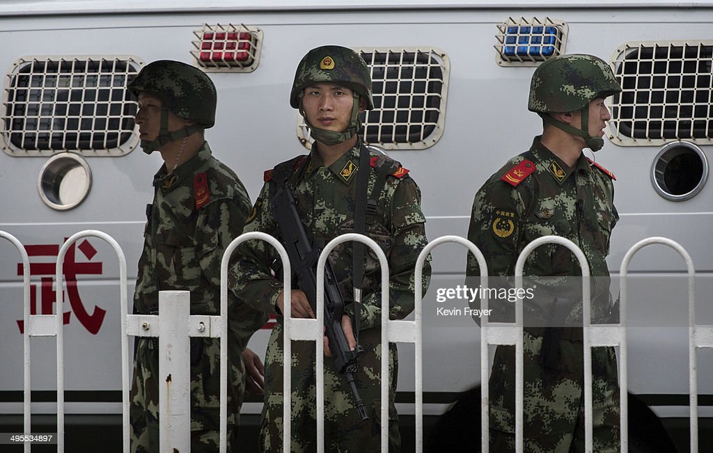 Chinese Paramilitary police officers stand guard near Tiananmen Square on June 4, 2014 in Beijing, China. Twenty-five years ago on June 4, 1989 Chinese troops cracked down on pro-democracy protesters and in the clashes that followed scores were killed and injured.