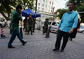 Chinese paramilitary police stand guard in the Muslim Uighur minority area of Urumqi Xinjiang Province on June 30 2013 Riots in China's ethnically...