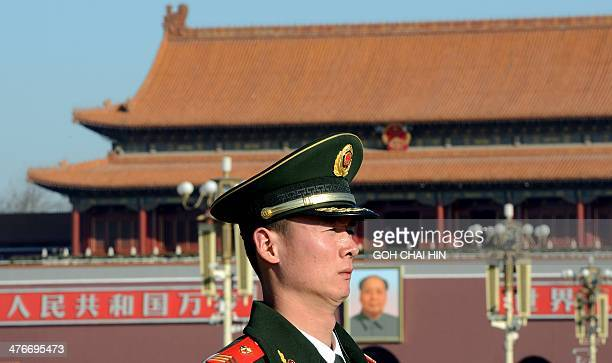 A Chinese paramilitary police stands guard on Tiananmen Square during the opening session of the 12th National People's Congress at the Great Hall of...