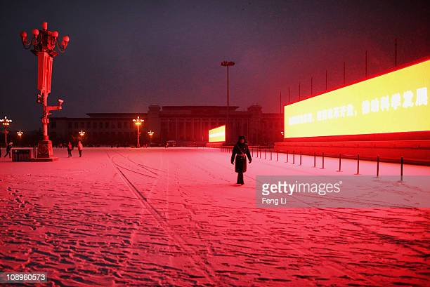 Chinese paramilitary policeman guards at the Tiananmen Square in the snow on February 10 2011 in Beijing China Winter snow fall began on Wednesday...