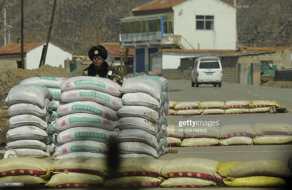 A Chinese paramilitary policeman guards the entrance to the county town of Banma in China's northwest Qinghai province on March 10, 2012. Chinese President Hu Jintao stressed the need to maintain stability in Tibet as he met legislators from the restive region, following a spate of self-immolations in Tibetan-inhabited areas. AFP PHOTO/Peter PARKS