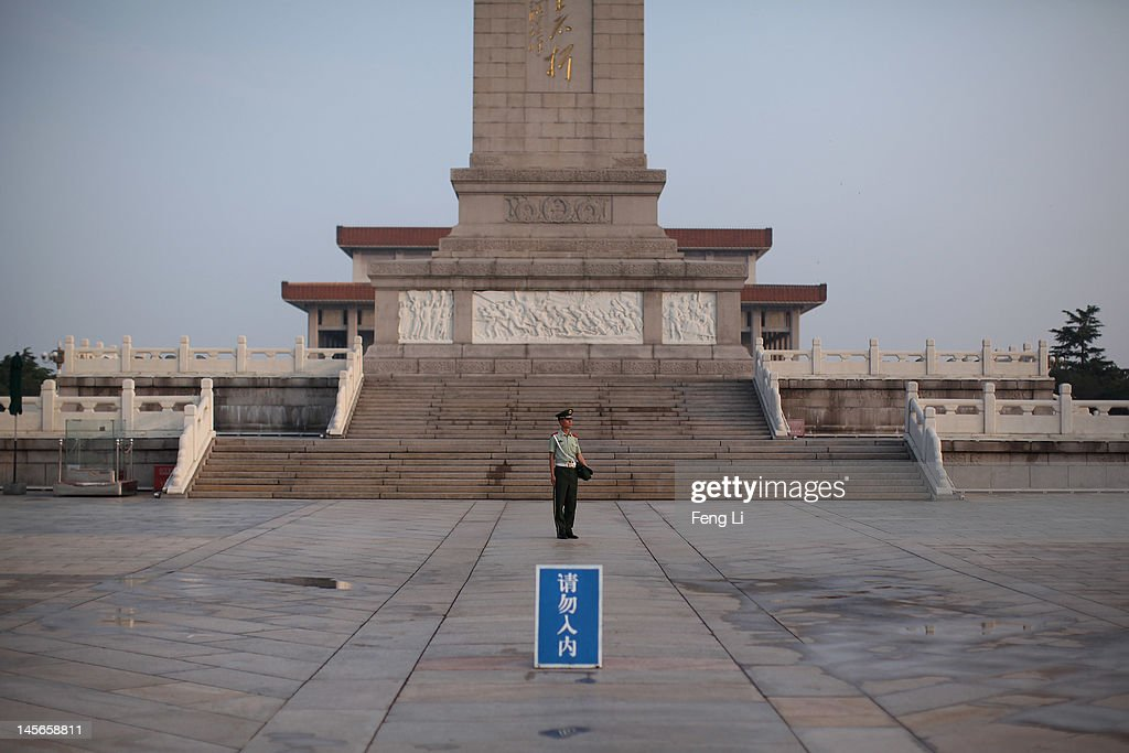 A Chinese paramilitary policeman guards under the Monument to the People's Heroes at the Tiananmen Square on June 3, 2012 in Beijing, China.