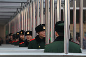 Chinese paramilitary policemen guard at the entrance of the checkin kiosks for realname tickets at Beijing West Railway Station on January 8 2012 in...