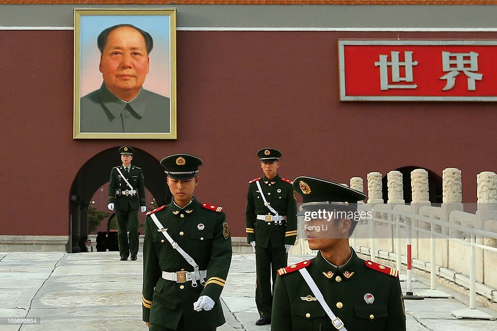 Chinese paramilitary policemen guard in front of the Tiananmen Gate on November 7, 2012 in Beijing, China. The18th National Congress of the Communist Party of China (CPC) is proposed to convene on November 8 in Beijing.