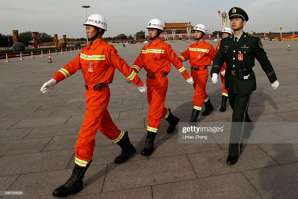 Chinese paramilitary policemen guard in front of the Tiananmen Square on November 7, 2012 in Beijing, China. The18th National Congress of the Communist Party of China (CPC) is proposed to convene on November 8 in Beijing.
