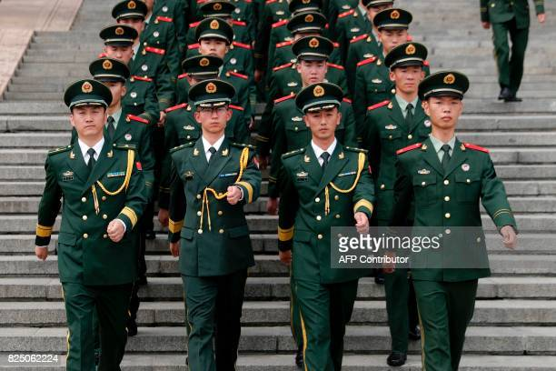 TOPSHOT Chinese paramilitary policemen march outside the Great Hall of the People after attending a ceremony to commemorate the 90th anniversary of...