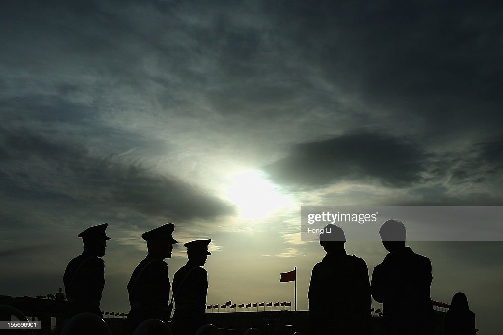 Chinese paramilitary policemen patrol at the Tiananmen Square on November 7, 2012 in Beijing, China. The18th National Congress of the Communist Party of China (CPC) is proposed to convene on November 8 in Beijing.