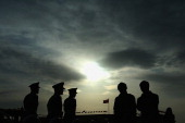 Chinese paramilitary policemen patrol at the Tiananmen Square on November 7 2012 in Beijing China The18th National Congress of the Communist Party of...