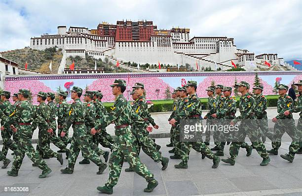 Chinese paramilitary policemen patrol in front of the Potala Palace during the ceremony for the 2008 Beijing Olympic Games torch relay in Lhasa on...