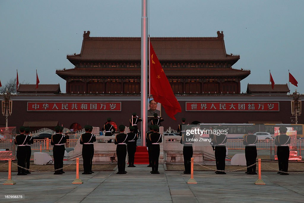 Chinese paramilitary policemen perform a flag lowering ceremony at Tiananmen on March 2, 2013 in Beijing, China. The reshuffle will be completed at the first annual session of the 12th National People's Congress (NPC), which is scheduled to begin on March 5, and the first annual session of the 12th National Committee of the Chinese People's Political Consultative Conference (CPPCC), which will commence on March 3.