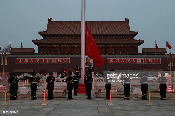 Chinese paramilitary policemen perform a flag lowering ceremony at Tiananmen on March 2 2013 in Beijing China The reshuffle will be completed at the...