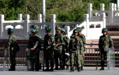 Chinese paramilitary policemen stand guard on a city square in Urumqi in China's Xinjiang region on May 24 2014 China has seen a series of incidents...