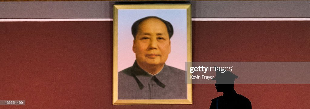 Chinese Paramilitary soldier stands guard in front of a portrait of the late leader Mao Zedong in front of the Forbidden City at Tiananmen Square on...