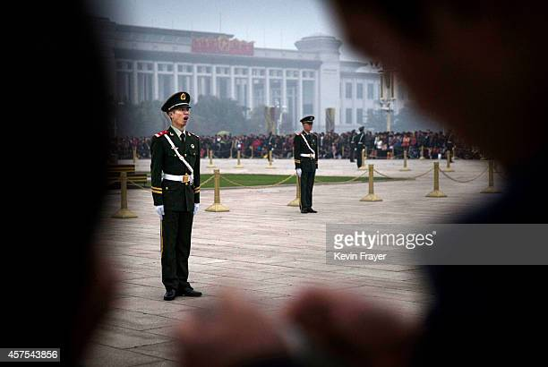 Chinese paramilitary soldier yawns as he stands at attention while guarding in Tiananmen Square on October 20 2014 in Beijing China Chinese Communist...