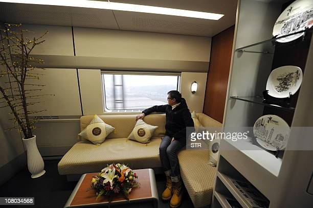 A Chinese passenger rests as he takes the newlylaunched bullet train bound for Beijing from southwest China's Chongqing municipality on January 11 as...