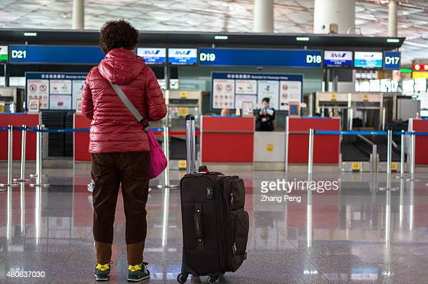 Chinese passenger waits outside ANA checkin counter in Terminal 3 of Beijing International Airport China will become the leading country for...
