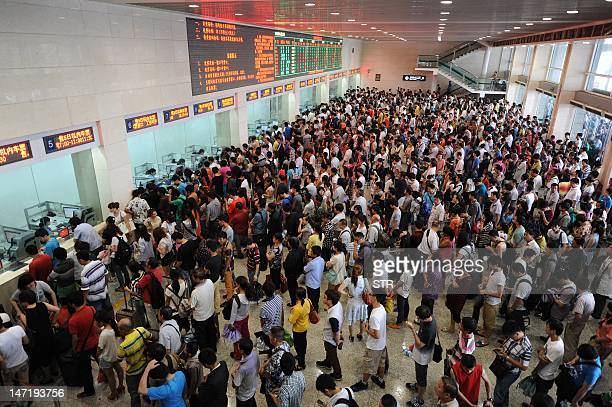 Chinese passengers queue up to buy train tickets as the summer holidays starts in Hefei in eastern China's Anhui province on June 27 2012 China's...