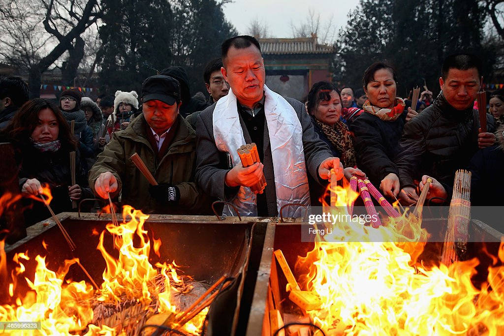 Chinese people burn incense for good fortune on the first day of the Chinese Lunar New Year at Yonghegong Lama Temple on January 31, 2014 in Beijing, China. The Chinese Lunar New Year of Horse also known as the Spring Festival, which is based on the Lunisolar Chinese calendar, is celebrated from the first day of the first month of the lunar year and ends with Lantern Festival on the Fifteenth day.