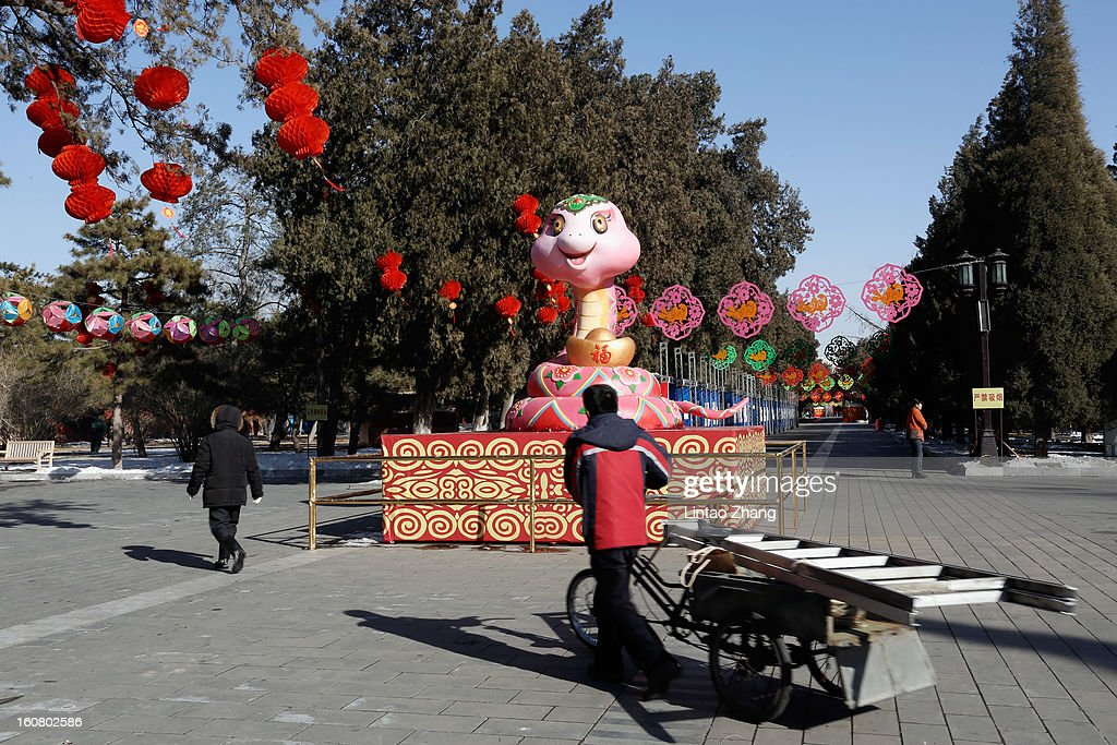 Chinese people decorate Ditan park to greet the New Year on February 6, 2013 in Beijing, China. Falling on February 10 this year, the Chinese Lunar New Year, also known as the Spring Festival, which is based on the Lunisolar Chinese calendar, is celebrated from the first day of the first month of the lunar year and ends with Lantern Festival on the Fifteenth day.