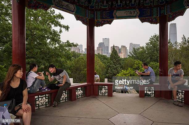 Chinese people gather in an overlook at Ritan Park in the evening on June 9 2016 in Beijing China Ritan meaning 'sun altar' is among the oldest parks...