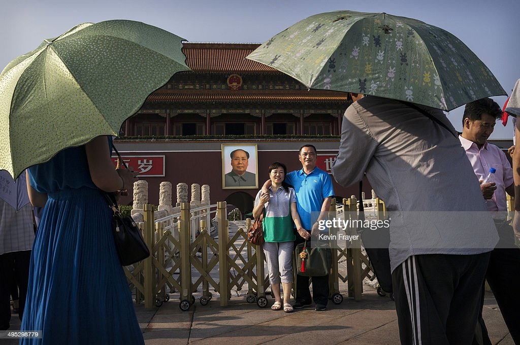 A Chinese people have their picture taken outside the Forbidden City at Tiananmen Square on June 2, 2014 in Beijing, China. Twenty-five years ago on June 4, 1989, Chinese troops cracked-down on pro-democracy protesters leaving scores dead and injured.