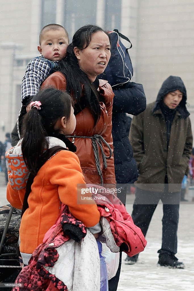Chinese people prepare to travel at the Beijing Railway Station on February 3, 2013 in Beijing, China. The Spring Festival travel season runs from January 26 to March 6 and according to reports road passenger transport in China is estimated at 3.1 billion people during this time of year.
