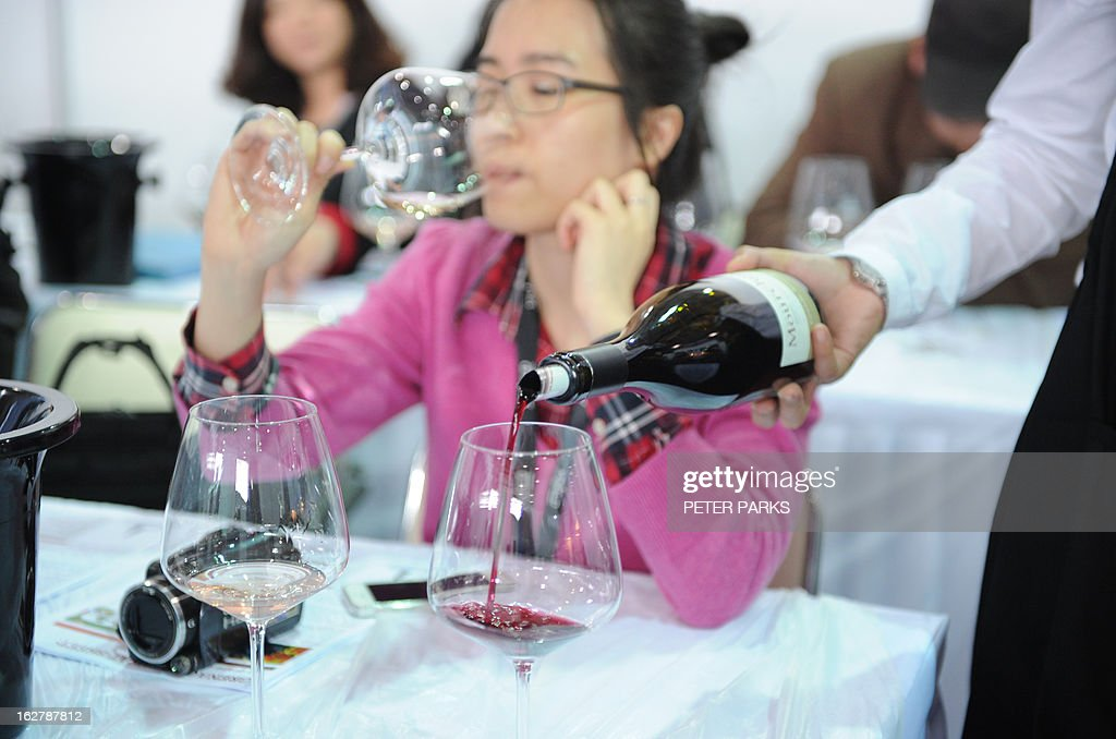Chinese people take a wine tasting course at the VINISUD, the world's leading Mediterranean wines fair being held in Shanghai on February 27, 2013. With average consumption of just one litre per person per year, China may not have an age-old wine tradition, but it is catching up fast and is expected to become the world's sixth largest wine consumer by 2014. AFP PHOTO/Peter PARKS