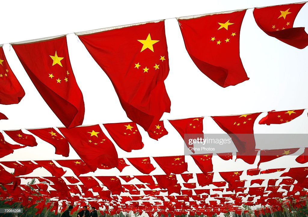 Chinese people visit a national flag show at Chaoyang park September 30, 2006 in Beijing, China. Chinese people are preparing for National Day Celebration, the 57th anniversary of the founding of People's Republic of China which falls on October 1.