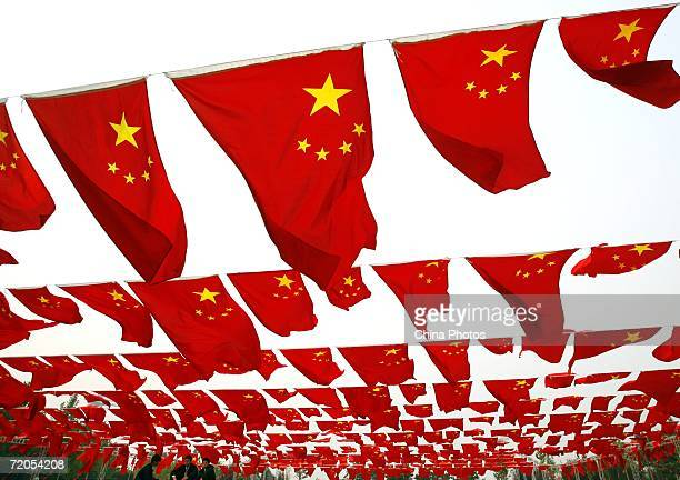 Chinese people visit a national flag show at Chaoyang park September 30 2006 in Beijing China Chinese people are preparing for National Day...