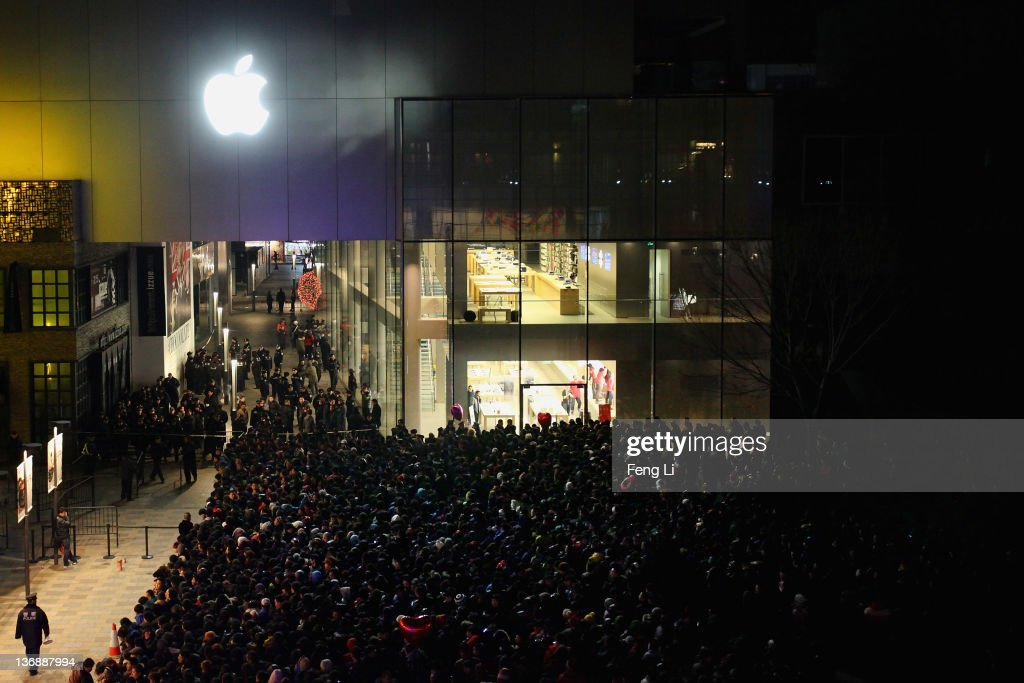 Chinese people wait outside an Apple store all night before the mainland release of iPhone 4S on January 13, 2012 in Beijing, China. Apple recently announced iPhone 4S will be released in China and 21 other countries on January 13.