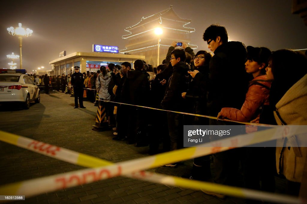 Chinese people wait to enter the subway station after visiting the ancient shopping area Qianmen Avenue during the Lantern Festival which falls on February 24 and traditionally marks the end of the Lunar New Year celebrations on February 24, 2013 in Beijing, China. The Lantern Festival is a Chinese festival celebrated on the fifteenth day of the first month in the lunar new year in the Chinese calendar.