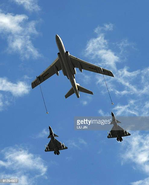Chinese People's Liberation Army airforce perform a fly during the National Day parade in Beijing on October 1 2009 China formally kicked off mass...