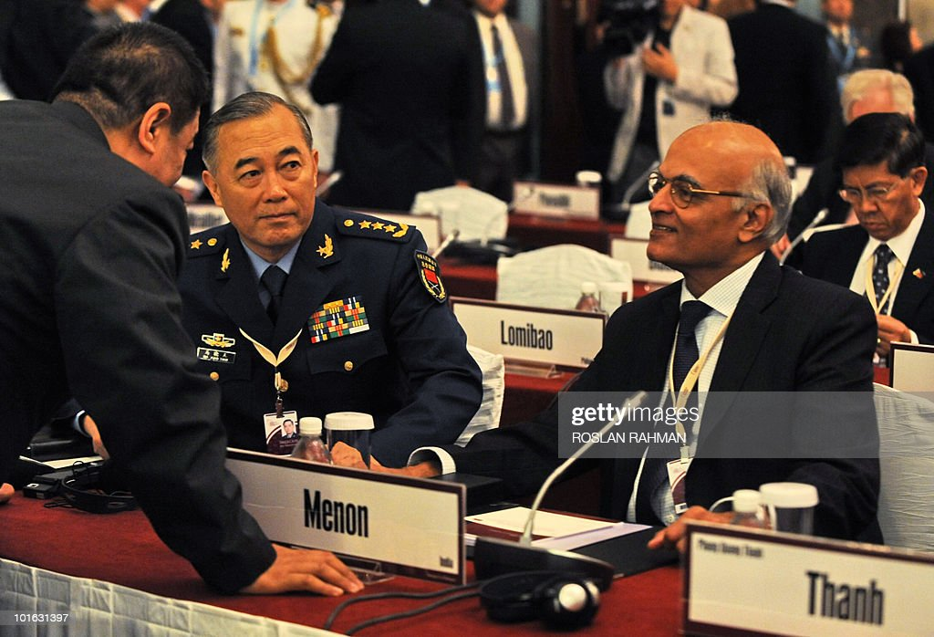Chinese People's Liberation Army Deputy Chief of General Staff Ma Xiaotian listens to his official while Shiv Shankar Menon, Indian National Security Advisor, looks on during the Asia-Pacific security forum in Singapore on June 5, 2010. The United States said it was weighing fresh steps to hold North Korea to account over the sinking of a South Korean warship, after Seoul appealed for UN intervention.
