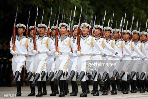 Chinese People's Liberation Army navy soldiers of a guard of honor rehearse before a welcoming ceremony for Bahrain's King Hamad Bin Eisa Al Khalifa...