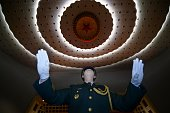 A Chinese People's Liberation Army officer practices conducting a military band before the opening session of the National People's Congress in...