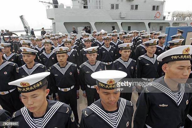 Chinese People's Liberation Army sailors stand at attention at a ceremony as they prepare to leave Hong Kong 25 November 2007 PLA troops usually...