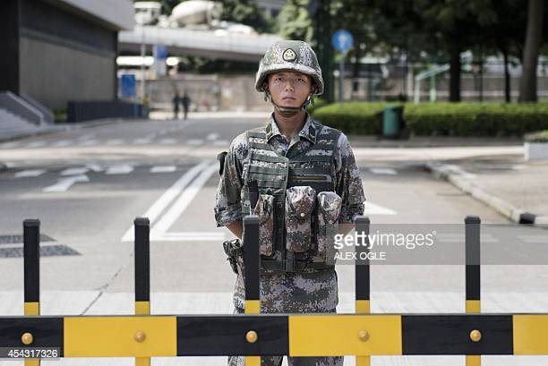 A Chinese People's Liberation Army soldier stands guard at the entrance to the PLA's Hong Kong Garrison headquarters in Hong Kong on August 29 2014...
